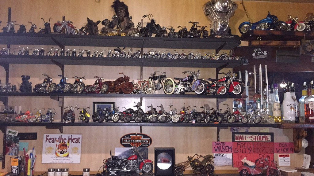 Collection of Motorcycle models (central one with large white tyres the original Harley Davidson! Log Cabin Pub, Spences Bridge, BC
